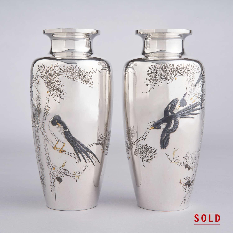 Japanese pair of silver vases signed Isshinsai Yoshihisa Meiji period