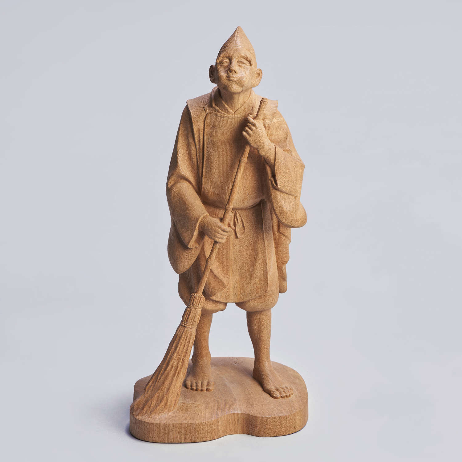 Japanese wood carving of a Shinto priest signed Choshun Shōwa period